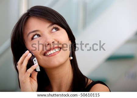 Business woman talking on the phone and smiling