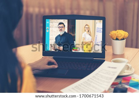 Business woman talking to colleagues about online sales in video conference - Multi ethnic business team using laptop for online meeting in video call - Group of people virtual smart working from home