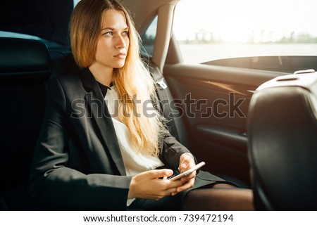 Business woman Talking Using Phone Car Inside
