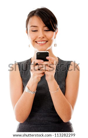 Business woman texting on her cell phone - isolated over a white background