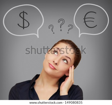 Business woman thinking about euro or dollar currency on grey background