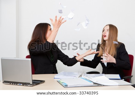 Business woman throws upwards the broken off document