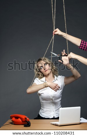business woman tied strings manipulated boss cutting rope scissors