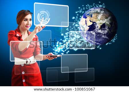 Business woman touch on window and digital world connected : Elements of this image furnished by NASA