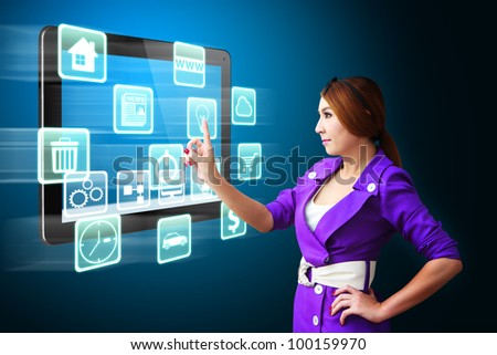 Business woman touch the many icons on tablet pc