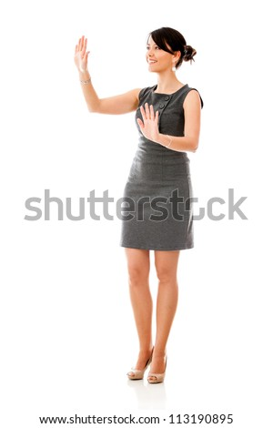 Business woman touching something imaginary - isolated over a white background