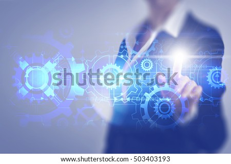 Business woman touching the screen of the mechanical gear #503403193