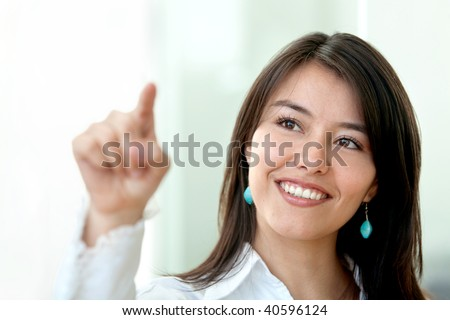 business woman touching the screen with her finger in an office