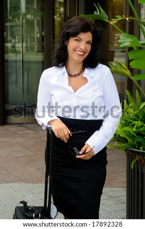 Business Woman Traveling With Her Rolling Luggage Outside Her Office