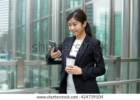 Business woman use of mobile phone oitside office