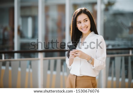 Business Woman Uses Smart phone on the street stock photo