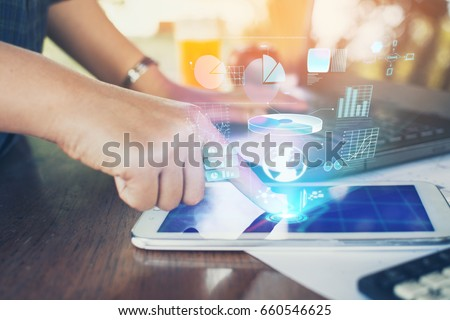 Business woman using a tablet to analysis marketing with digital light. #660546625