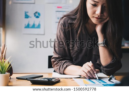Business woman using calculator for do math finance on wooden desk in office and business working background, tax, accounting, statistics and analytic research concept Foto d'archivio ©