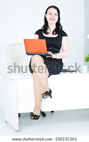 Business woman using laptop sitting on the table