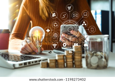 business woman using smartphone, tablet and holding light bulb, with using smartphone concept idea with innovation and creativity VR icon  #1198273402