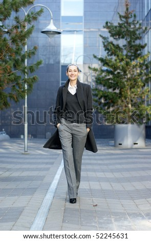 Business woman walking in the park