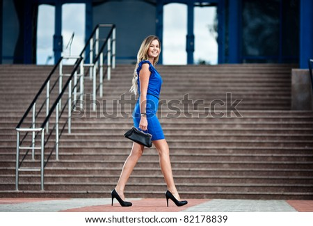 Business woman walking on the street