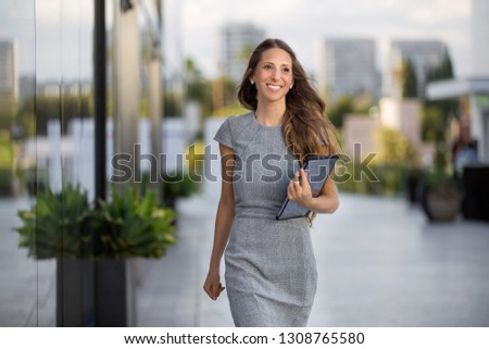 Business woman walking to office, cheerful, upbeat, with a positive mind and attitude
