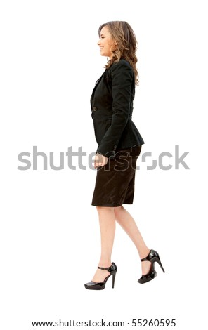 Business woman walking to the side isolated over a white background