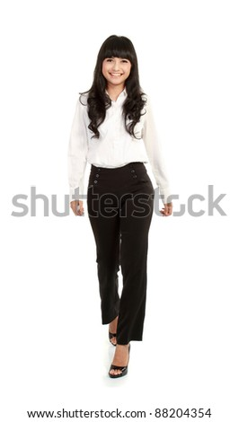 business woman walking towards the camera isolated over a white background