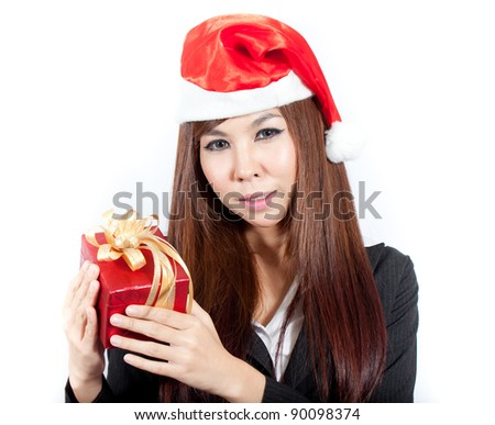 Business woman wearing a santa hat and holding a christmas gift