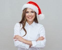 Business woman wearing Santa red hat. Smiling santa girl isolated portrait.