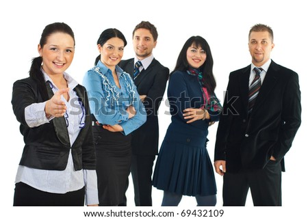 Business woman welcome sign hand gesture  and her team smiling in background