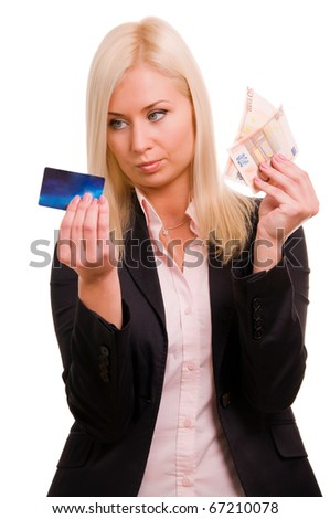 Business woman with a credit card and cash in her hand