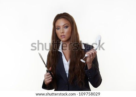 business woman with a pair of scissors cutting the cord to her work phone
