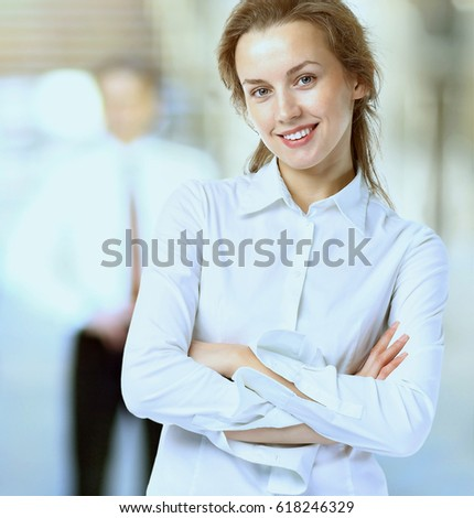Business woman with a positive look and a cheerful smile, on a team work background #618246329