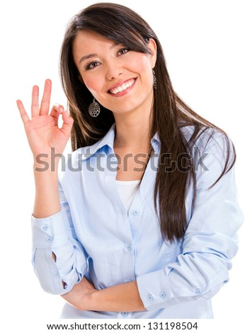 Business woman with an ok sign - isolated over a white background