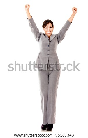 Business woman with arms up celebrating her success - isolated over white