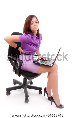 Business woman with back pain after long work on chair.