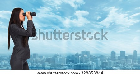 Business woman with binoculars over modern urban background.