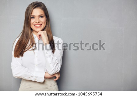 Business woman with folded hand standing against gray wall background. Copy space. #1045695754