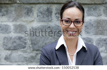 Business woman with glasses outside Stock photo ©