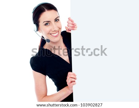 Business woman with headset and banner ad isolated over white background