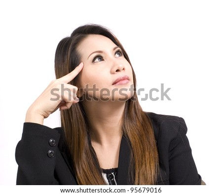 business woman with her finger on her head - stock photo