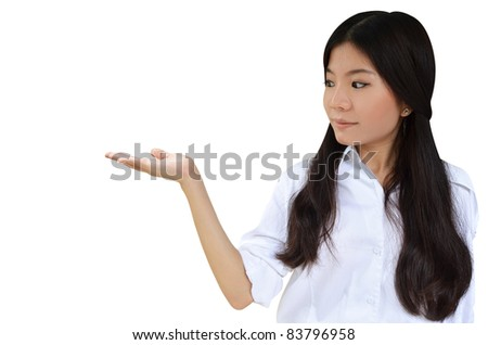 Business woman with her hand open to show a product isolated on white background