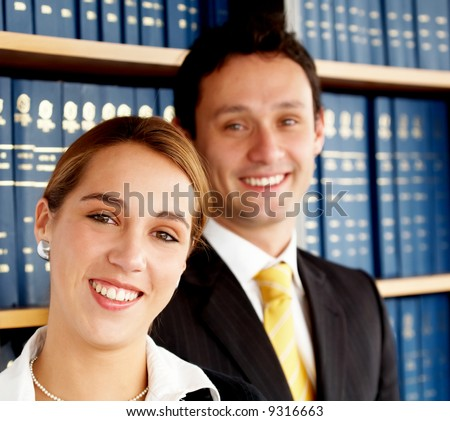 business woman with her partner in an office smiling