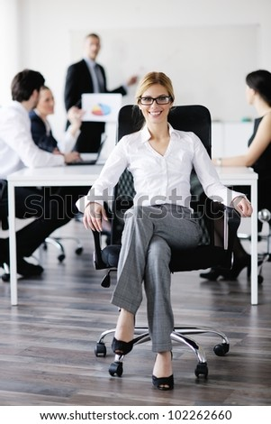 business woman  with her staff,  people group in background at modern bright office indoors