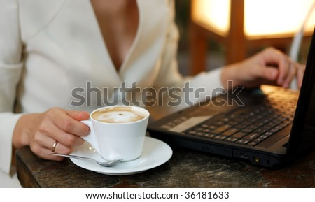 business woman with laptop and cup of coffee
