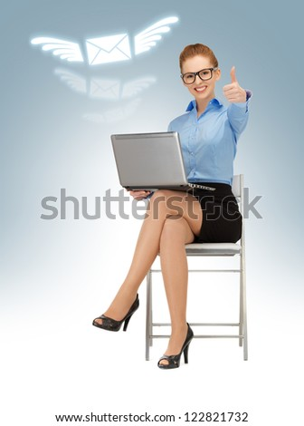 business woman with laptop showing thumbs up