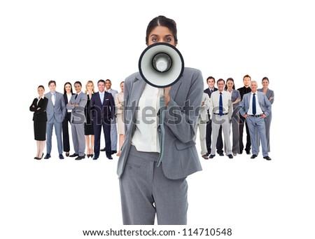 Business woman with megaphone standing in front of other busines people