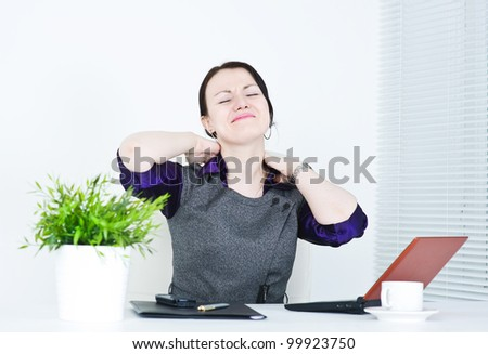 Business woman with pain in her neck - stock photo
