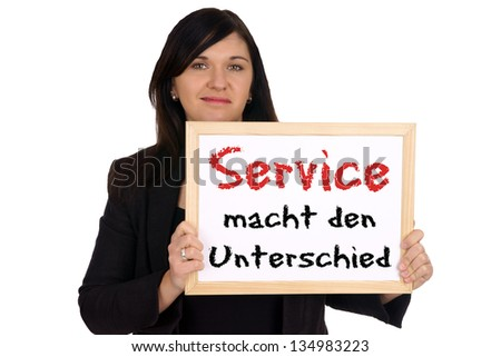 Business woman with shield and the german words Service makes the difference / service