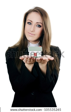 Business woman with small model of house - stock photo
