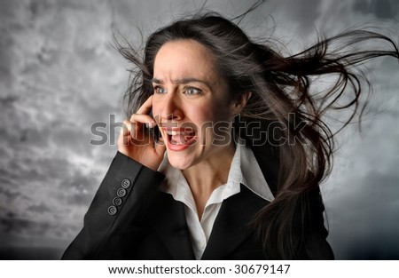 business woman with worried expression on the phone