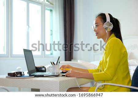 business woman working a laptop computer from a home and conference meeting