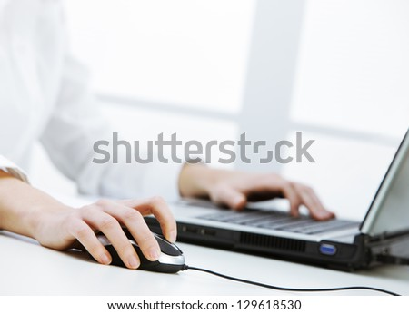 Business woman working at the computer, hand close up